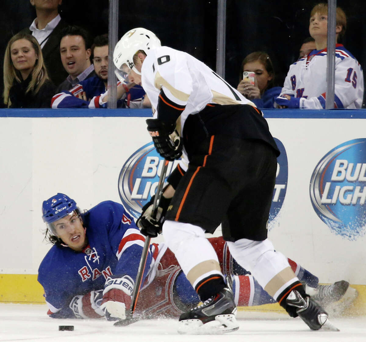 Anaheim Ducks right wing Corey Perry (10) gets control of the puck as New York Rangers defenseman Michael Del Zotto (4) lies on the ice in the first period of an NHL hockey game at Madison Square Garden in New York, Monday, Nov. 4, 2013. (AP Photo/Kathy Willens)