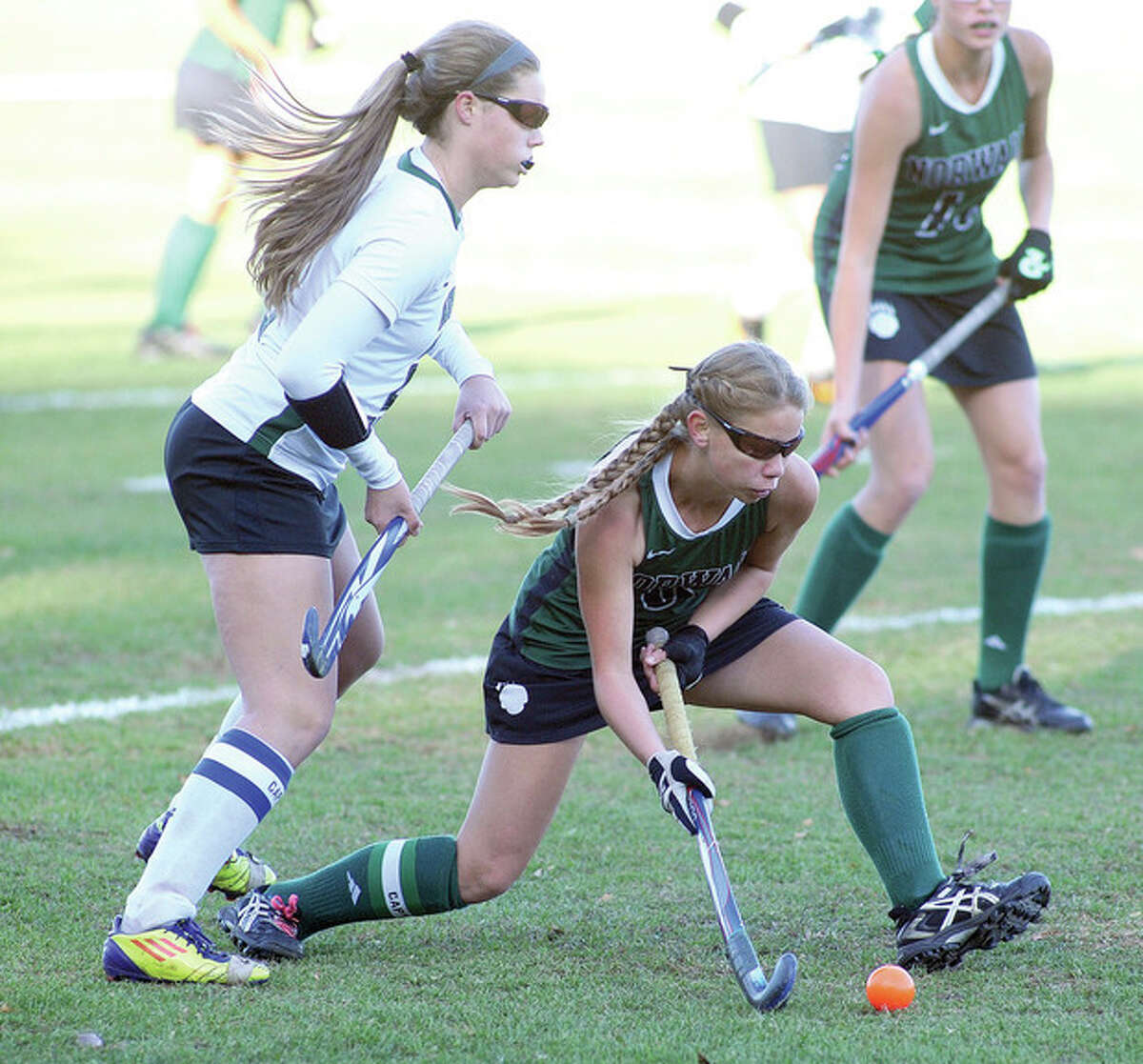 Hour photo/John Nash Norwalk's Greta McConnell, bottom, gets ready to push the ball up the field as New Milford's Corinne Heymach trails during Monday's Class LL prelim game. New Milford won, 1-0, ending the Bears season.