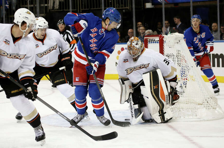 New York Rangers center Derick Brassard (16) takes a shot but misses as Anaheim Ducks goalie Frederik Andersen (31) of Denmark defends in the second period of their NHL hockey game at Madison Square Garden in New York, Monday, Nov. 4, 2013. (AP Photo/Kathy Willens) / AP