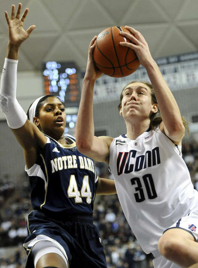 FILE - In this Jan. 5, 2013 file photo, Connecticut's Breanna Stewart (30) drives to the basket while guarded by Notre Dame's Ariel Braker during the second half of an NCAA college basketball game in Storrs, Conn. Stewart was selected to The Associated Press' preseason women's All-America team, released Tuesday, Nov. 5, 2013. (AP Photo/Jessica Hill, File)