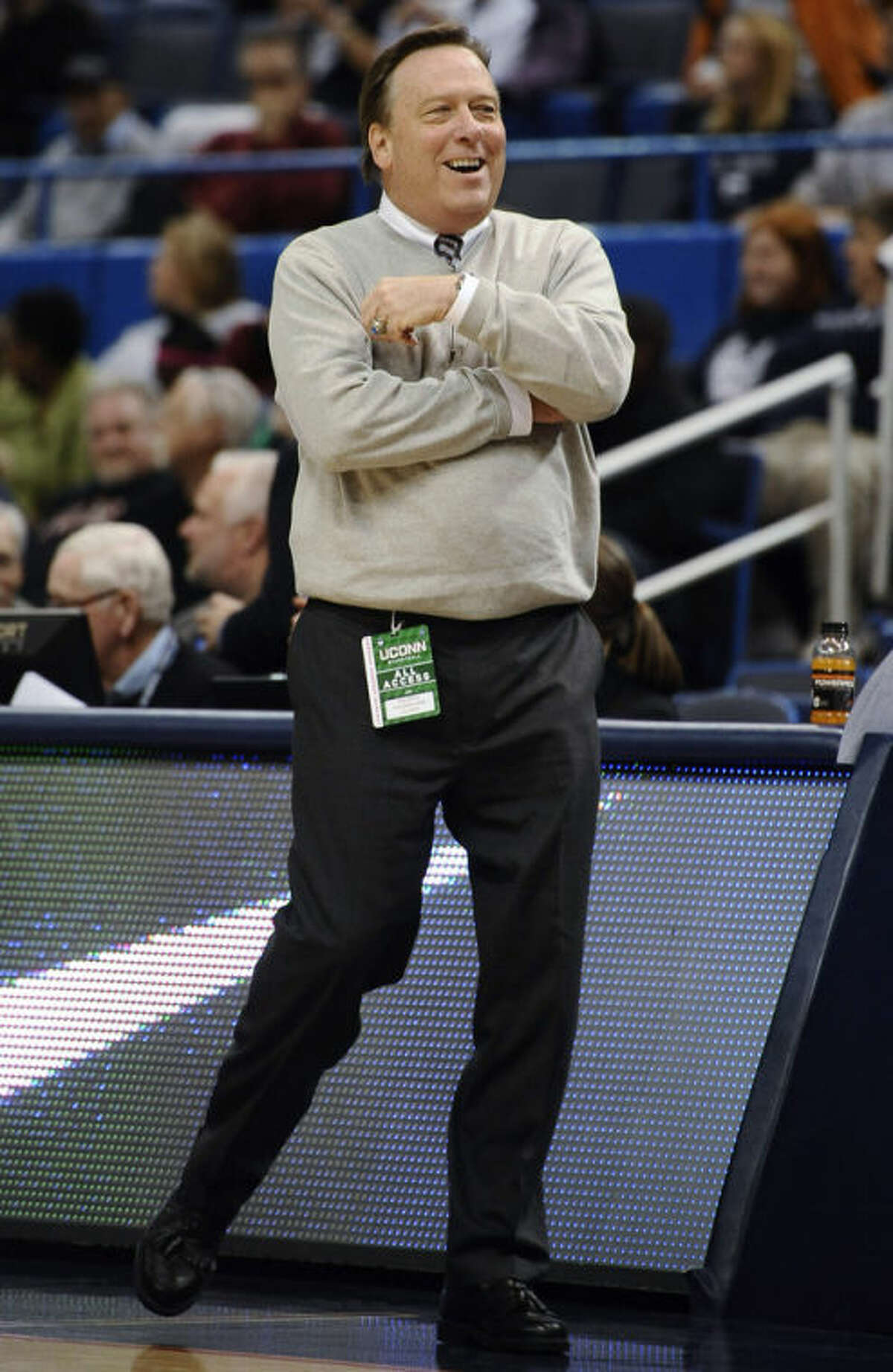 Philadelphia coach Tom Shirley smiles during the first half of an NCAA college exhibition basketball game against Connecticut, Tuesday, Nov. 5, 2013, in Hartford, Conn. (AP Photo/Jessica Hill)
