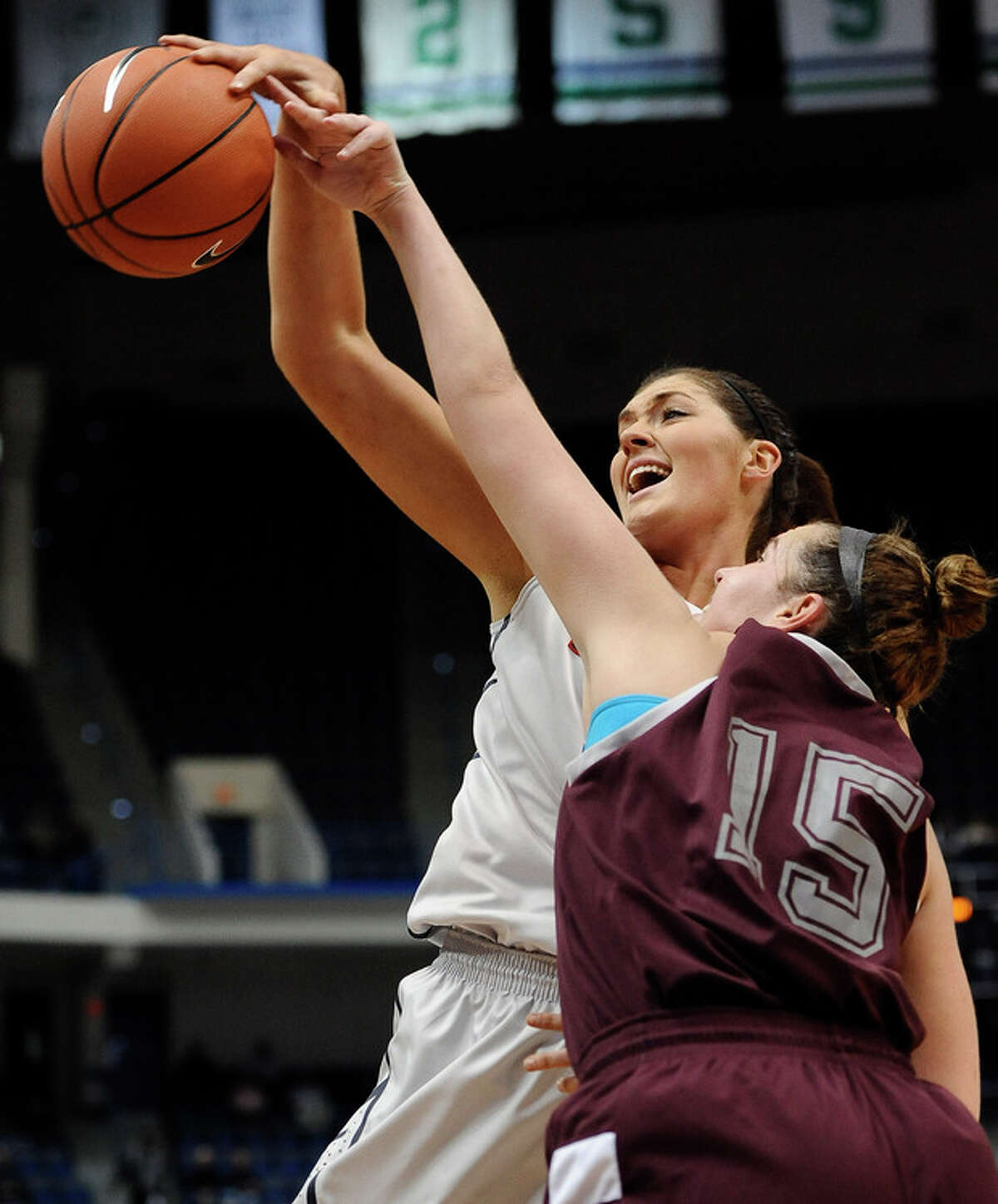 Connecticut's Stefanie Dolson, left, and Philadelphia's Tori Arnao, right, lookfor control of the ball during the first half of an NCAA college exhibition basketball game, Tuesday, Nov. 5, 2013, in Hartford, Conn. (AP Photo/Jessica Hill)