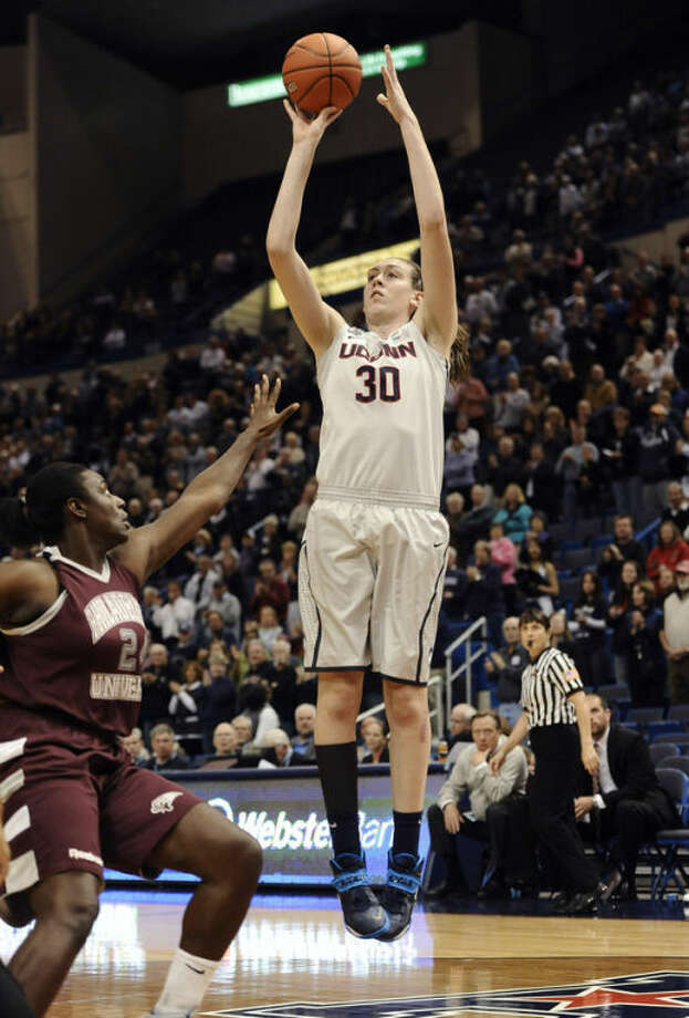 Connecticut's Breanna Stewart, right, goes up for a shotas Philadelphia's Mary Newell, left, defends during the first half of an NCAA college exhibition basketball game, Tuesday, Nov. 5, 2013, in Hartford, Conn. (AP Photo/Jessica Hill)