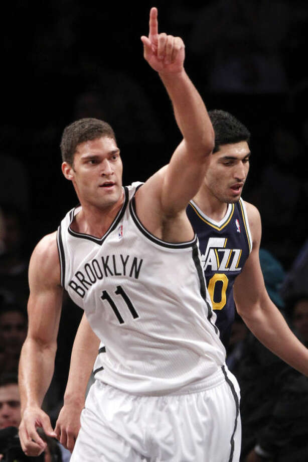 Brooklyn Nets' Brook Lopez reacts after scoring against the Utah Jazz during an NBA basketball game Tuesday, Nov. 5, 2013, in New York. Brooklyn won 104-88. (AP Photo/Jason DeCrow)