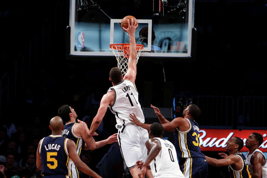 Brooklyn Nets' Brook Lopez (11) dunks against against the Utah Jazz during the first half of an NBA basketball game Tuesday, Nov. 5, 2013, in New York. (AP Photo/Jason DeCrow) / FR103966 AP