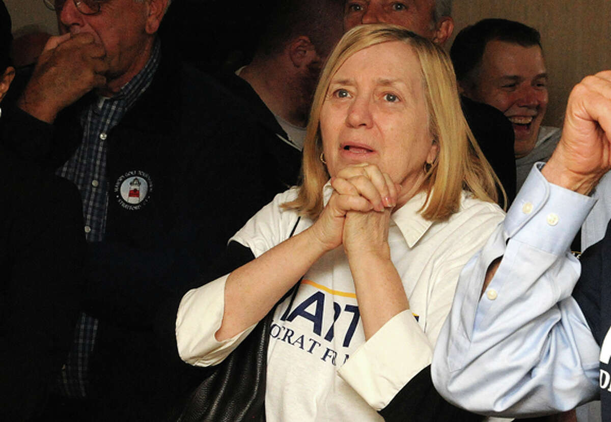 David Martin supporter Barbara Tepper watches results in the Stamford mayoral race Tuesday. photo/Matthew Vinci