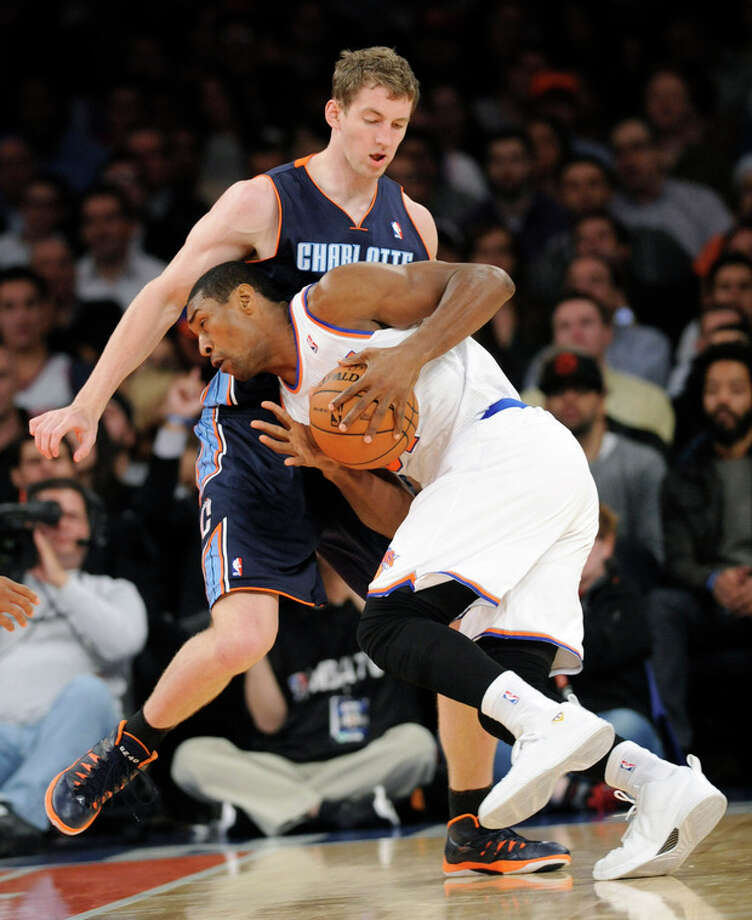 New York Knicks' Metta World Peace runs into Charlotte Bobcats' Cody Zeller during the third quarter of an NBA basketball game Tuesday, Nov. 5, 2013, at Madison Square Garden in New York. The Bobcats defeated the Knicks 102-97. (AP Photo/Bill Kostroun) / FR51951 AP