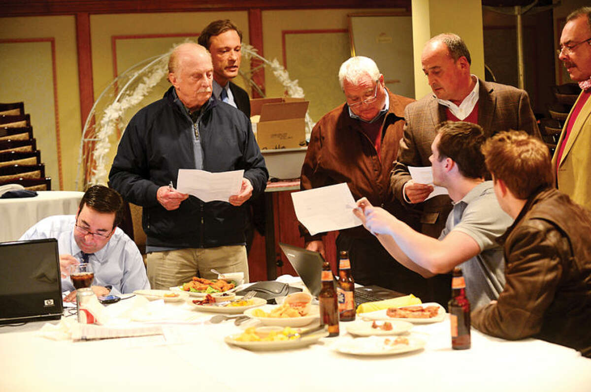 Hour photo / Erik Trautmann Numbers come into the GOP war room during election night at the Norwalk Inn Tuesday.