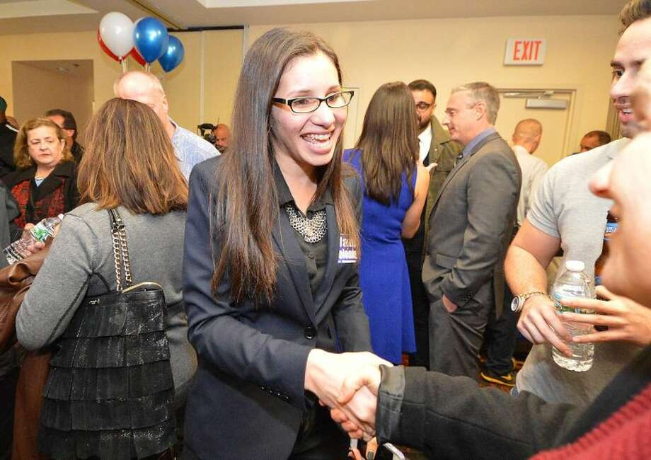 Hour Photo/Alex von Kleydorff . Eloisa Melendz shakes hands with supporters for her win on Election Night to the Common Council