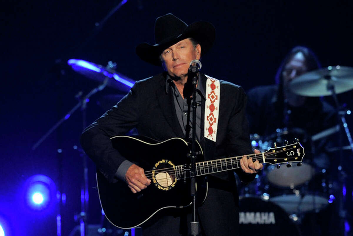 FILE - This April 7, 2013 file photo shows George Strait performing at the 48th Annual Academy of Country Music Awards at the MGM Grand Garden Arena in Las Vegas. Strait was awarded the Founder?'s Award at the ASCAP Country Awards on Monday night, Nov. 4, 2013, in Nashville, Tenn. (Photo by Chris Pizzello/Invision/AP, File)