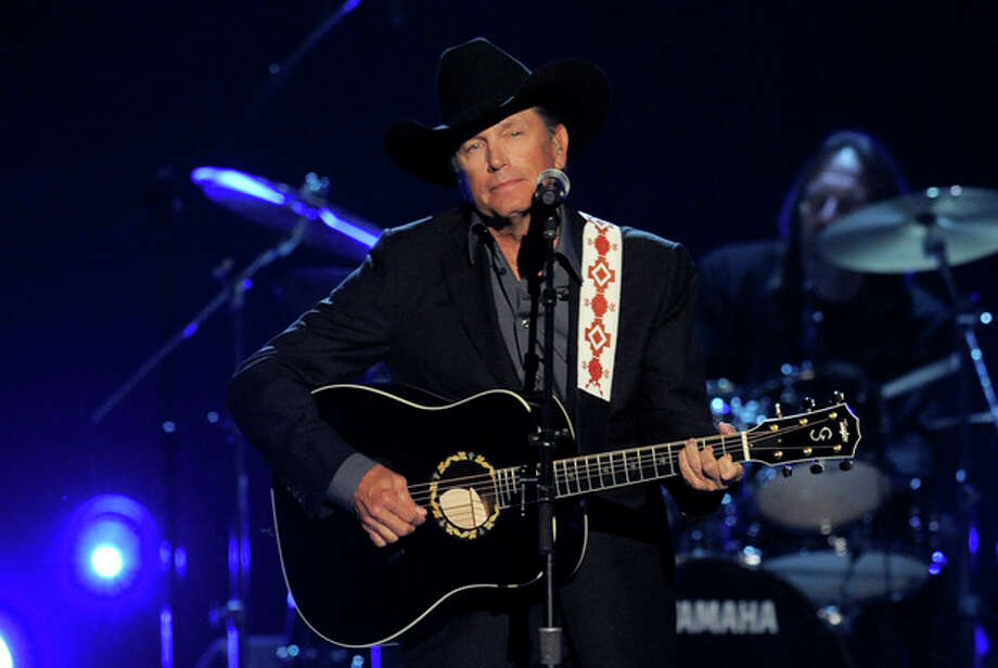 FILE - This April 7, 2013 file photo shows George Strait performing at the 48th Annual Academy of Country Music Awards at the MGM Grand Garden Arena in Las Vegas. Strait was awarded the Founder's Award at the ASCAP Country Awards on Monday night, Nov. 4, 2013, in Nashville, Tenn. (Photo by Chris Pizzello/Invision/AP, File) / Invision