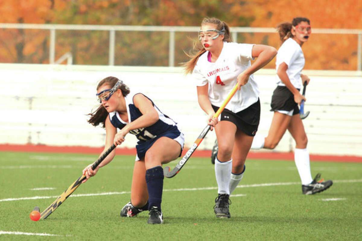 Hour photo/Chris Palermo Staples' Meg Fay, left, keeps the ball away from Greenwich's Madeline Graves during Wednesday's state tournament game in Greenwich. Fay had the Wreckers' only goal in a 3-1 loss.