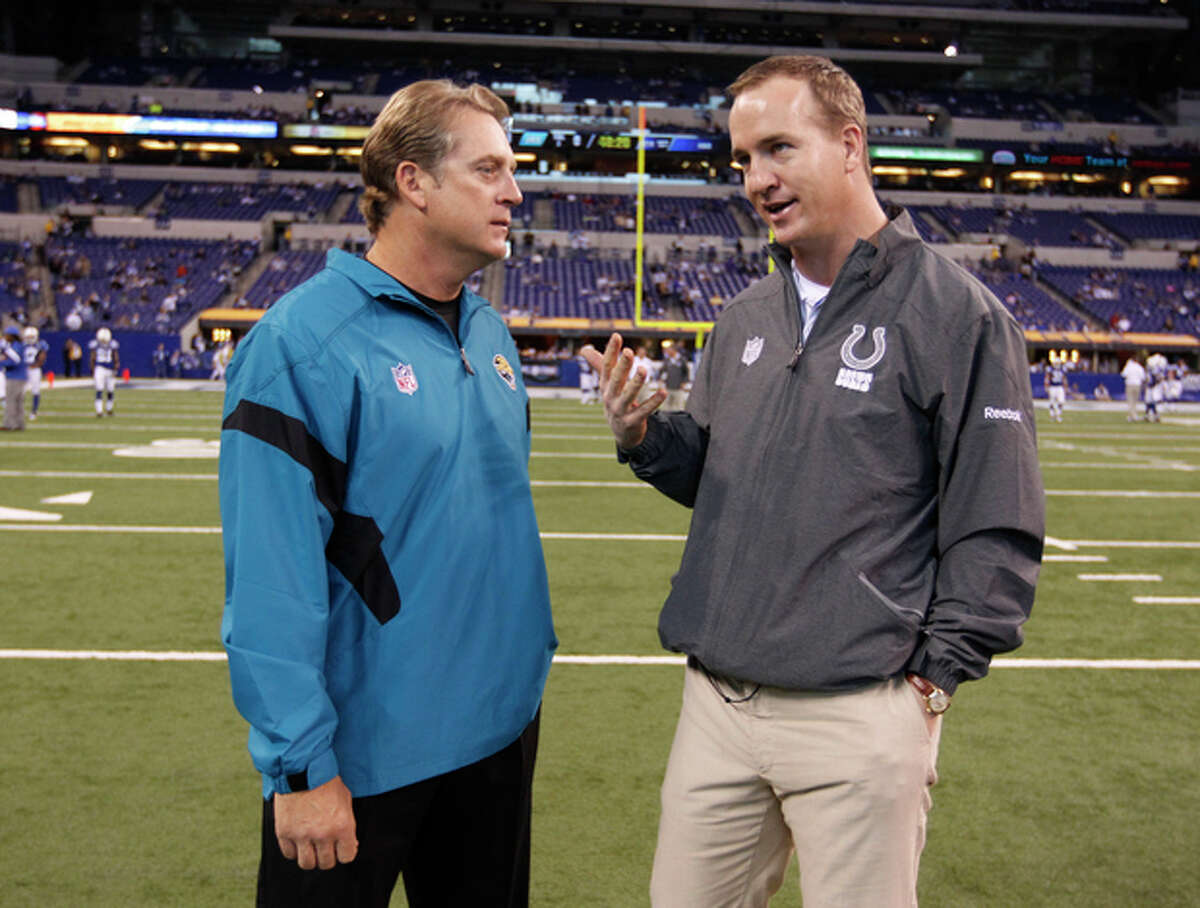 FILE - In this Nov. 13, 2011 file photo, Indianapolis Colts quarterback Peyton Manning, right, talks with Jacksonville Jaguars head coach Jack Del Rio before an NFL football game in Indianapolis. Del Rio, now the interim head coach for the Broncos, says it's imperative to be on the same page with his quarterback, Peyton Manning, although Denver's interim head coach is likely to follow in John Fox's footsteps in handing the offense to Manning and getting the heck out of the way. (AP Photo/Michael Conroy, File)