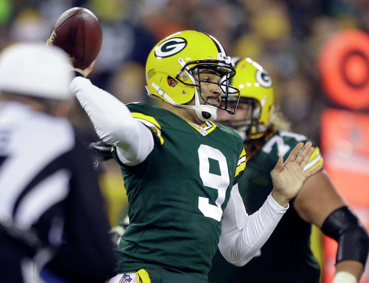 FILE - In this Nov. 4, 2013, file photo, Green Bay Packers quarterback Seneca Wallace throws during the first half of an NFL football game against the Chicago Bears, in Green Bay, Wis. Wallace replaced Aaron Rodgers, who has a fractured left collarbone. (AP Photo/Jeffrey Phelps, File)