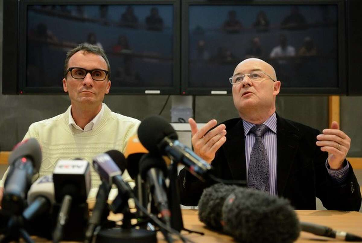 Swiss professor Francois Bochud, left, director of the Chuv Radiophysics Institute, IRA, and Swiss professor Patrice Mangin, right, director of the University Center of Legal Medicine in Lausanne, CURML, speak on a forensics report concerning the late President Yasser Arafat during a press conference at the Centre Hospitalier Universitaire Vaudois, CHUV, in Lausanne, Switzerland, Thurday, Nov. 7, 2013. Swiss, French and Russian teams took samples of the remains after exhuming Arafat's body in Ramallah, and submitted results to the Palestinian Authority on Nov. 5. (AP Photo/Keystone, Laurent Gillieron)