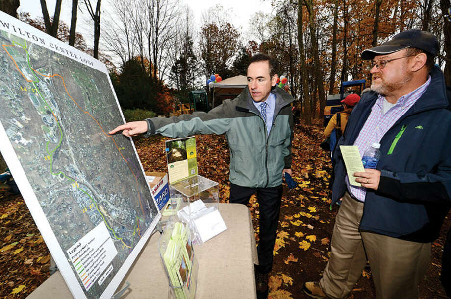 Supporters of the Norwalk River Valley Trail expansion in Wilton point out the loop trail that will be built during a ground breaking ceremony for the first phase of the loop Thursday.