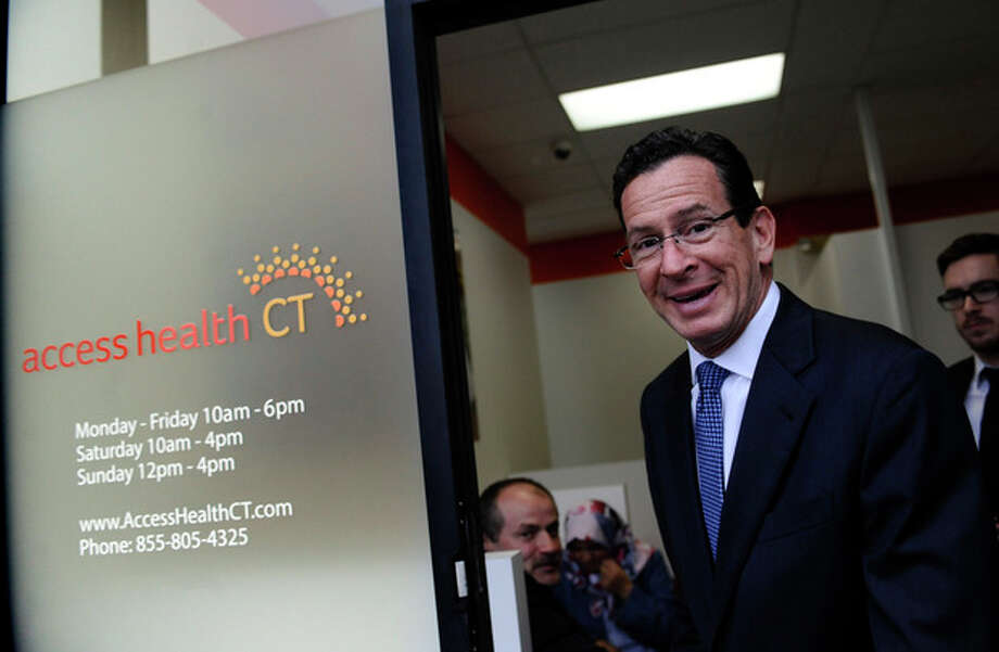 Connecticut Gov. Dannel P. Malloy leaves a grand opening for Connecticut's health insurance exchange's first insurance store, Access Health CT, Thursday, Nov. 7, 2013, in New Britain, Conn. The site, where people can visit to sign up for coverage, is the first in the nation. (AP Photo/Jessica Hill) / FR125654 AP