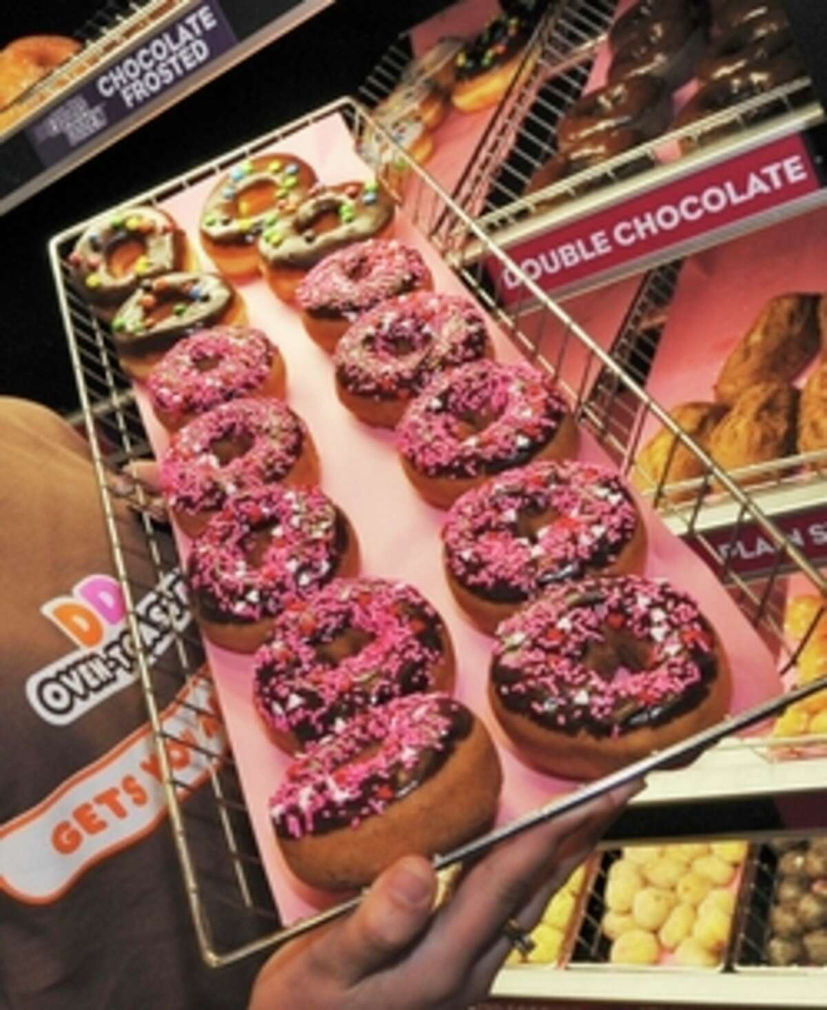 FILE - In this Feb. 12, 2008 file photo, a rack of donuts is displayed at a Dunkin' Donuts franchise in Boston. Consumers wondering what food without trans fat will taste like, probably already know as food manufacturers began eliminating it years ago. (AP Photo/Lisa Poole, File)