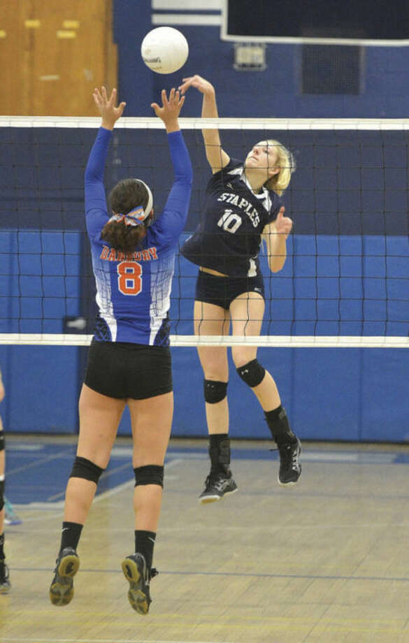 Amelia Brackett ofStaples, right, goes up for a kill during Thursday's girls volleyball state tournament match against Danbury. Brackett had 22 kills in the second-seeded Wreckers' 3-1 win.Hour Photo/ Alex von Kleydorff