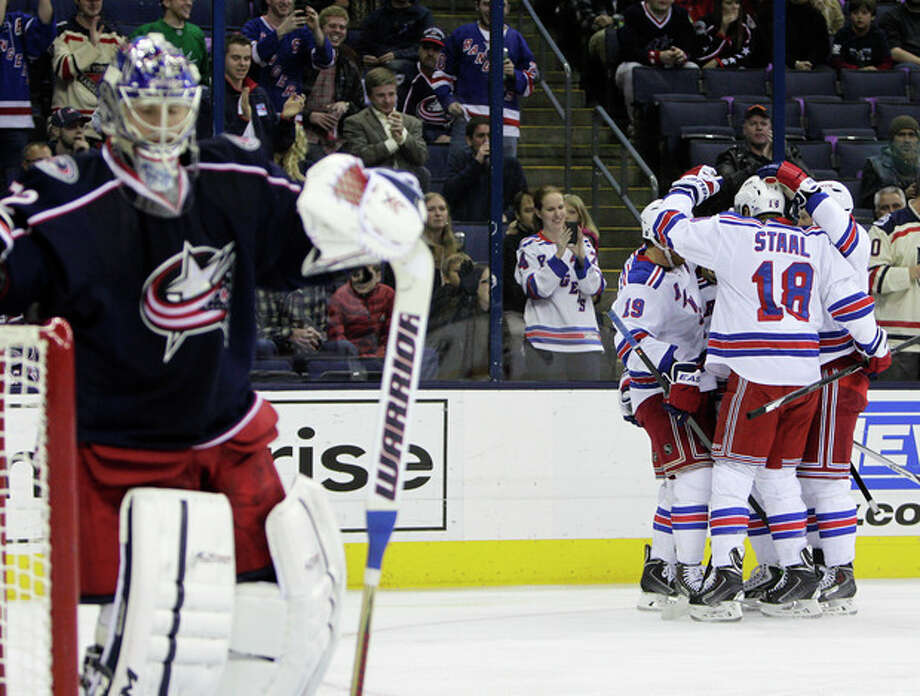 New York Rangers' players celebrate their goal against Columbus Blue Jackets' Sergei Bobrovsky, of Russia, during the first period of an NHL hockey game Thursday, Nov. 7, 2013, in Columbus, Ohio. (AP Photo/Jay LaPrete) / FR52593 AP