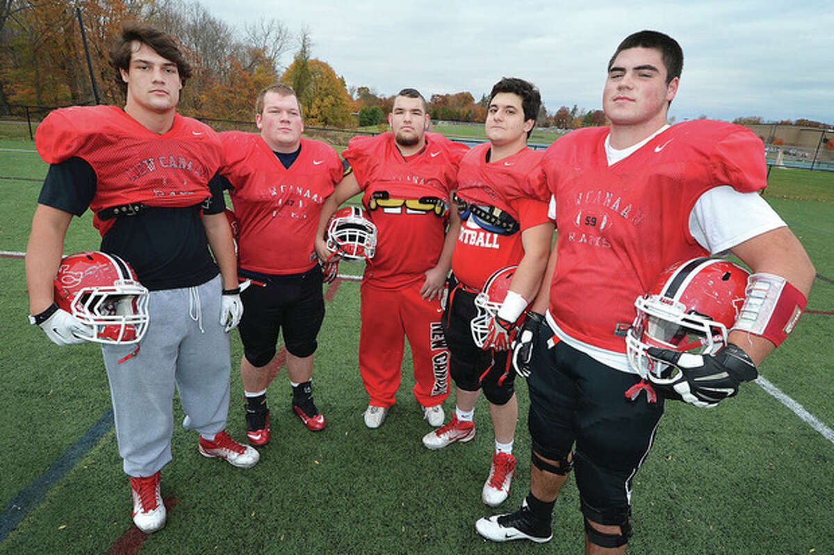 Hour photo/Alex von Kleydorff The members of New Canaan's offensive line, from left, Beau Santero, Jim Keneally, Ryan McKenna, Joao Rocha and Mike Donnelly, are a tight and talented group that often comes off the field correcting their own mistakes and making their own adjustments. They are key to the Rams' success with the ball.