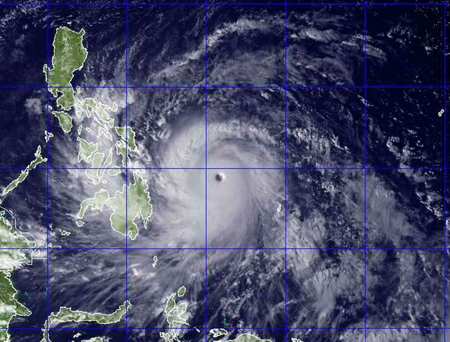 This image provided by the U.S. Naval Research Lab shows Typhoon Haiyan taken by the NEXSAT satellite Thursday Nov. 7, 2013 at 2:30 a.m. EDT. Gorvernment forecasters said Thursday that Typhoon Haiyan was packing sustained winds of 215 kilometers (134 miles) per hour and ferocious gusts of 250 kph (155 mph) and could pick up strength over the Pacific Ocean before it slams into the eastern Philippine province of Eastern Samar on Friday. (AP Photo/US Naval Research Lab) / U.S. Naval Research Lab