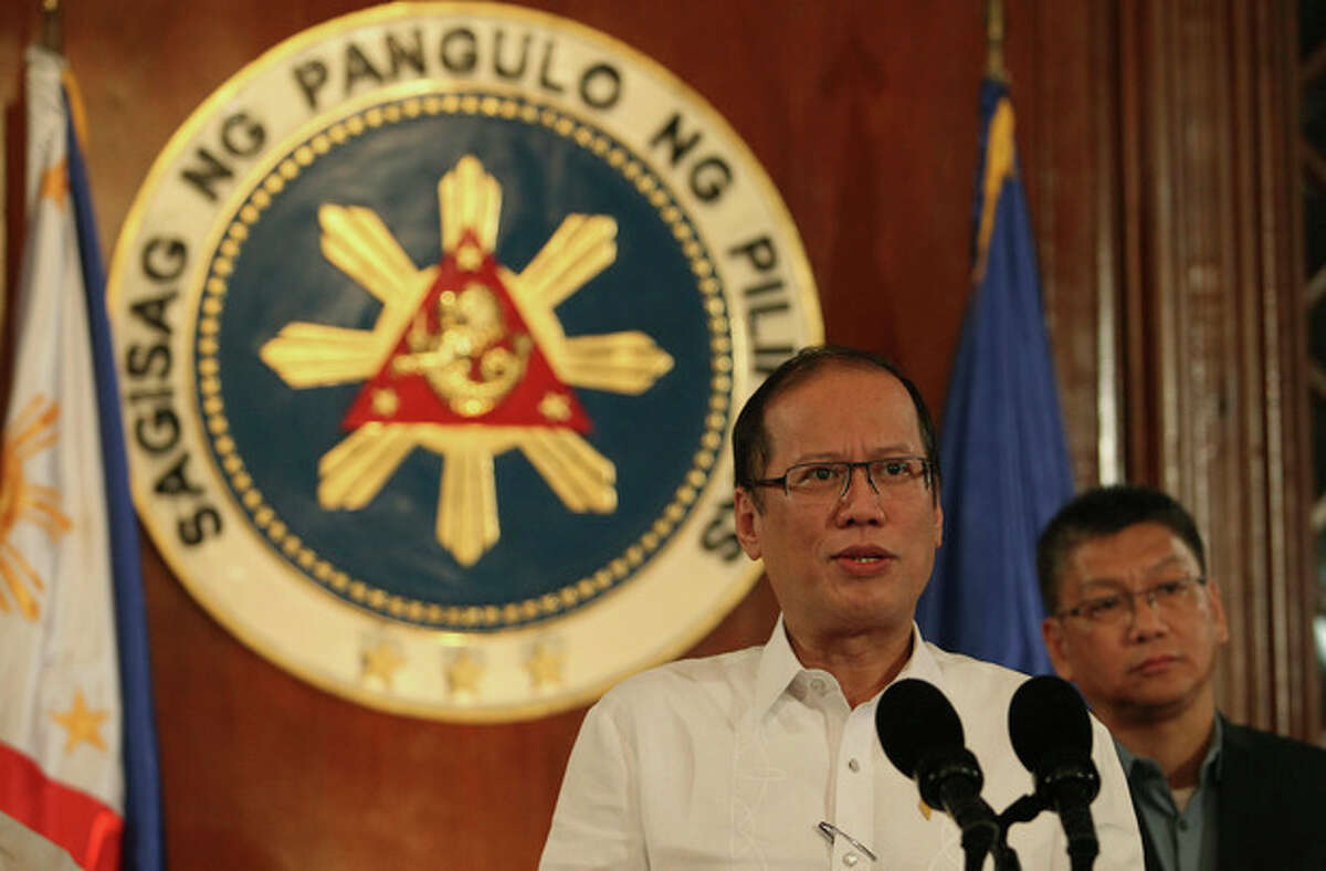 In this photo released by the Malacanang Photo Bureau, Philippine President Benigno Aquino III speaks about Typhoon Haiyan during a nationally televised address at the Malacanang palace in Manila, Philippines on Thursday Nov. 7, 2013. Thousands of people evacuated villages in the central Philippines on Thursday before one of the year's strongest typhoons strikes the region, including a province devastated by an earthquake last month. Standing at right is Executive Secretary Paquito Ochoa Jr. (AP Photo/Malacanang Photo Bureau, Robert Vinas)