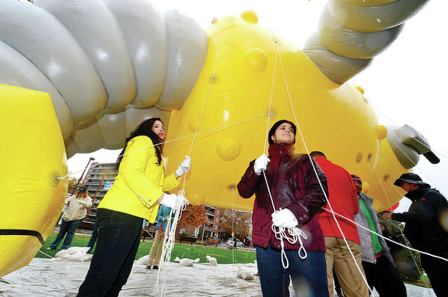 Hour photo / Erik Trautmann Joia and Allegra Calderano train as balloon handlers for the upcoming UBS Thanksgiving Parade following a press conference announcing the event Thursday at Latham Park / (C)2013, The Hour Newspapers, all rights reserved