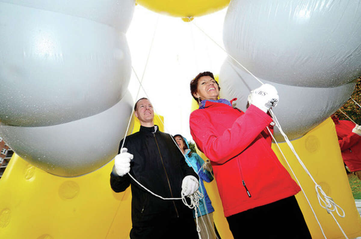 Hour photo / Erik Trautmann Brian Van Irper and Hilda Valladares train as balloon handlers for the upcoming UBS Thanksgiving Parade following a press conference announcing the event Thursday at Latham Park