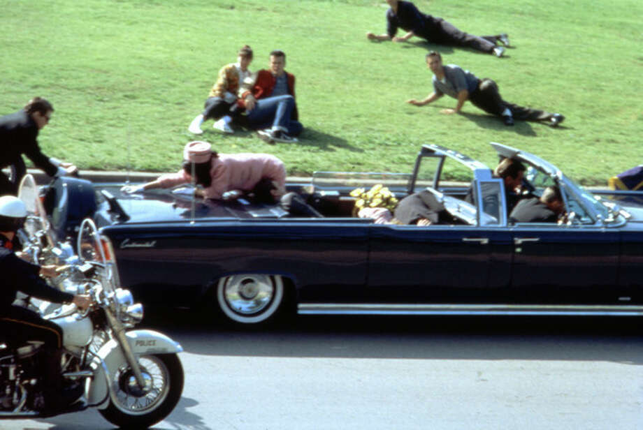 "ADVANCE FOR USE SUNDAY, NOV. 10, 2013 AND THEREAFTER - This image provided by Warner Bros. from Oliver Stone's 1991 movie ""JFK"" shows a recreation of the assassination of U.S. President John F. Kennedy in Dallas. ""This murder in broad daylight ... Everything changed,"" says Stone, the Baby Boomer director who served in Vietnam and made a movie about it before turning his critical lens on the Kennedy assassination. (AP Photo/Warner Bros.) / Warner Bros."