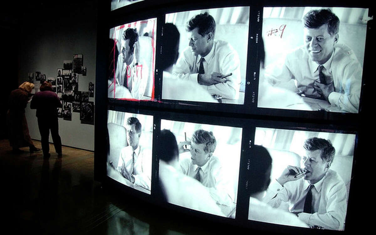 ADVANCE FOR USE SUNDAY, NOV. 10, 2013 AND THEREAFTER - FILE - This Friday, Nov. 20, 2003 file photo shows a display of photographs of U.S. President John F. Kennedy at the Sixth Floor Museum in Dallas. The candid contact-sheet images on display at the museum are all that remains of the Jacques Lowe collection. More than 40,000 of his negatives of the Kennedy family were destroyed in the 2001 World Trade Center attacks. (AP Photo/LM Otero)
