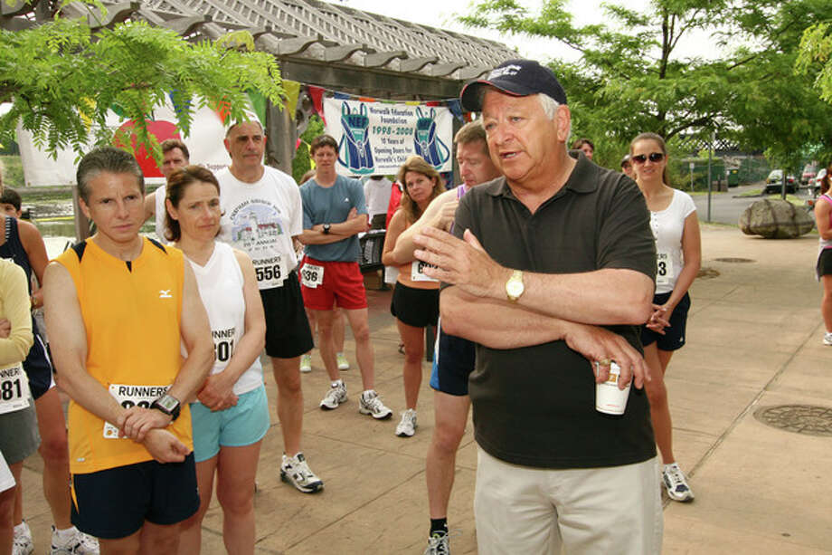 """Mayor Moccia welcomes all of the participants and discusses the importance of the first annual """"Run for Education"""" which benefits the Norwalk Education Foundation Sunday morning in SoNo.Hour photo / DAVID ESPOSITO"""