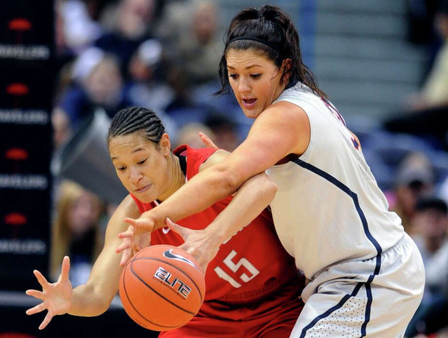 Hartford forward Milana Gilbert (15) is guarded by Connecticut center Stefanie Dolson (31) during the first half of an NCAA college basketball game in Hartford, Conn., on Saturday, Nov. 9, 2013. (AP Photo/Fred Beckham) / FR153656 AP
