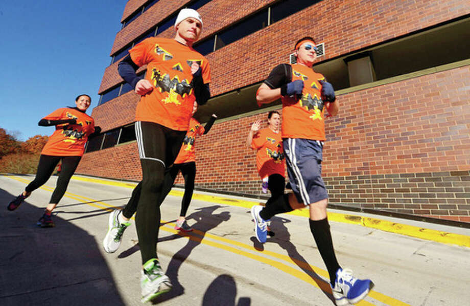 Hour photo / Erik Trautmann The Rolling Pumpkins participate in Reed Exhibitions annual 5K run for charity Friday benefiting the Bridgeport Rescue Mission. / (C)2013, The Hour Newspapers, all rights reserved