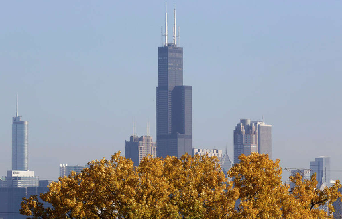 FILE - This Nov. 7, 2013, photo shows a partial view of Chicago's 110 story, 1,450 foot Willis Tower. The Tower is in contention with the 104-story, 1,776 foot One World Trade Center, a skyscraper built at the site of the 9/11 attacks on the World Trade Center in New York as the tallest building in America. A committee of architects recognized as the arbiters on world building heights is meeting Friday Nov. 8, 2013 in Chicago to decide whether a design change affecting One World Trade Center's needle disqualifies its hundreds of feet from being counted, which would deny the building the title of nation?'s tallest giving the title to Willis Tower. (AP Photo/M. Spencer Green)