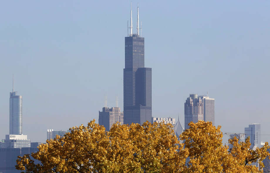 FILE - This Nov. 7, 2013, photo shows a partial view of Chicago's 110 story, 1,450 foot Willis Tower. The Tower is in contention with the 104-story, 1,776 foot One World Trade Center, a skyscraper built at the site of the 9/11 attacks on the World Trade Center in New York as the tallest building in America. A committee of architects recognized as the arbiters on world building heights is meeting Friday Nov. 8, 2013 in Chicago to decide whether a design change affecting One World Trade Center's needle disqualifies its hundreds of feet from being counted, which would deny the building the title of nation's tallest giving the title to Willis Tower. (AP Photo/M. Spencer Green) / AP