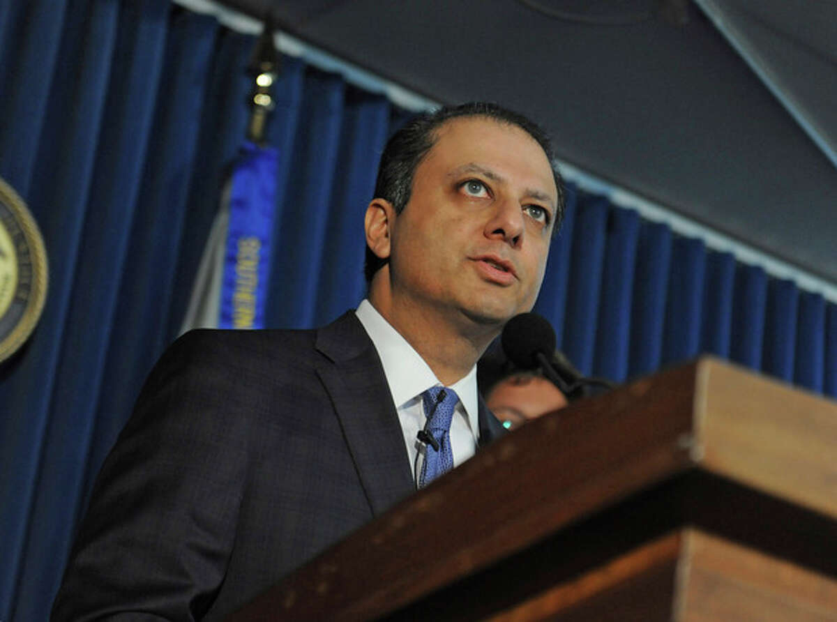 U.S. Attorney Preet Bharara speaks at a press conference, Monday, Nov. 4, 2013, in New York. Federal prosecutors in New York say hedge fund giant SAC Capital Advisors has agreed to plead guilty to fraud charges and to pay a $1.8 billion financial penalty. (AP Photo/ Louis Lanzano)