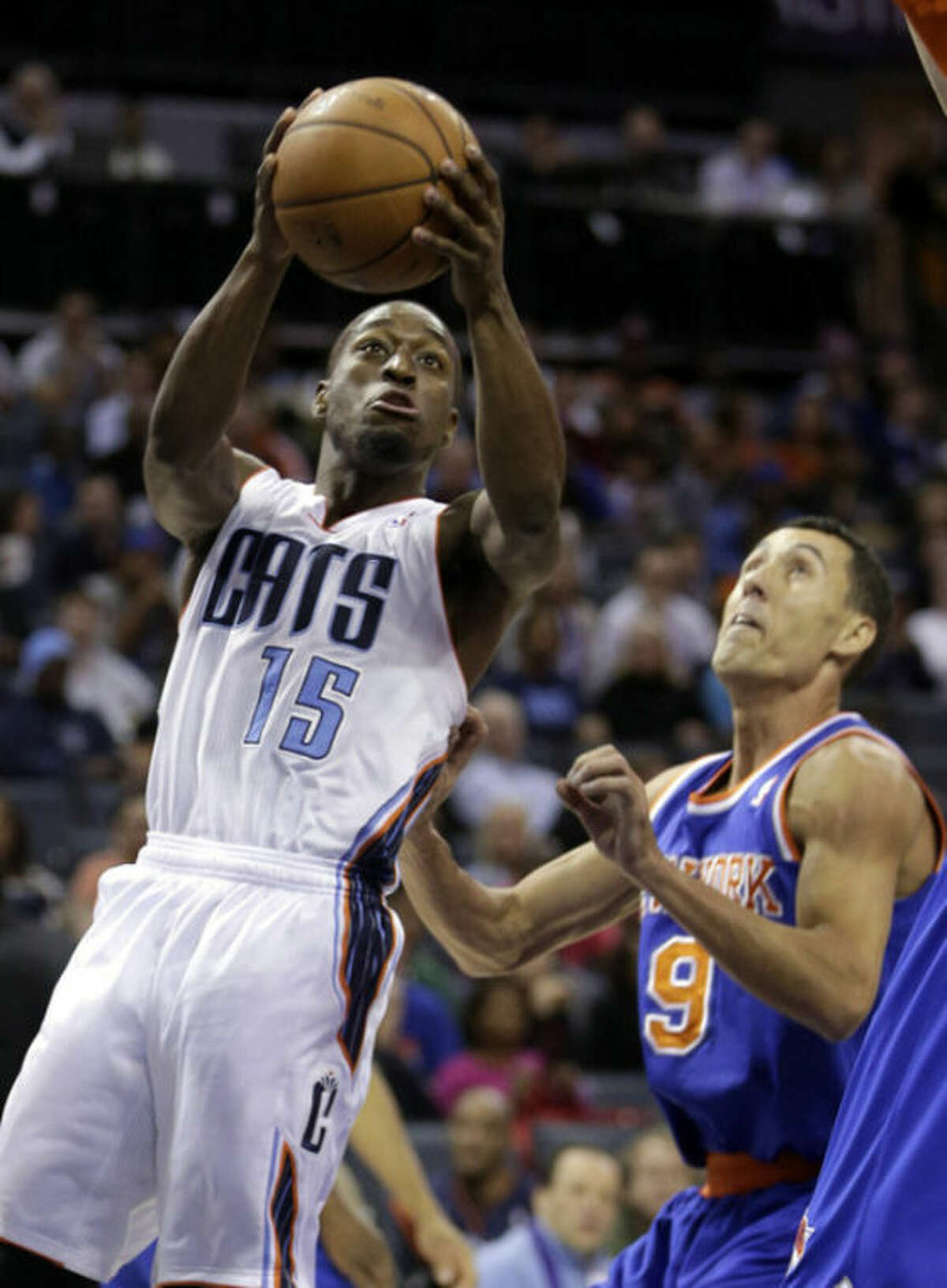 Charlotte Bobcats guard Kemba Walker, left, drives past New York Knicks guard Pablo Prigioni, of Argentina, in the first half of an NBA basketball game in Charlotte, N.C., Friday, Nov. 8, 2013. (AP Photo/Nell Redmond)