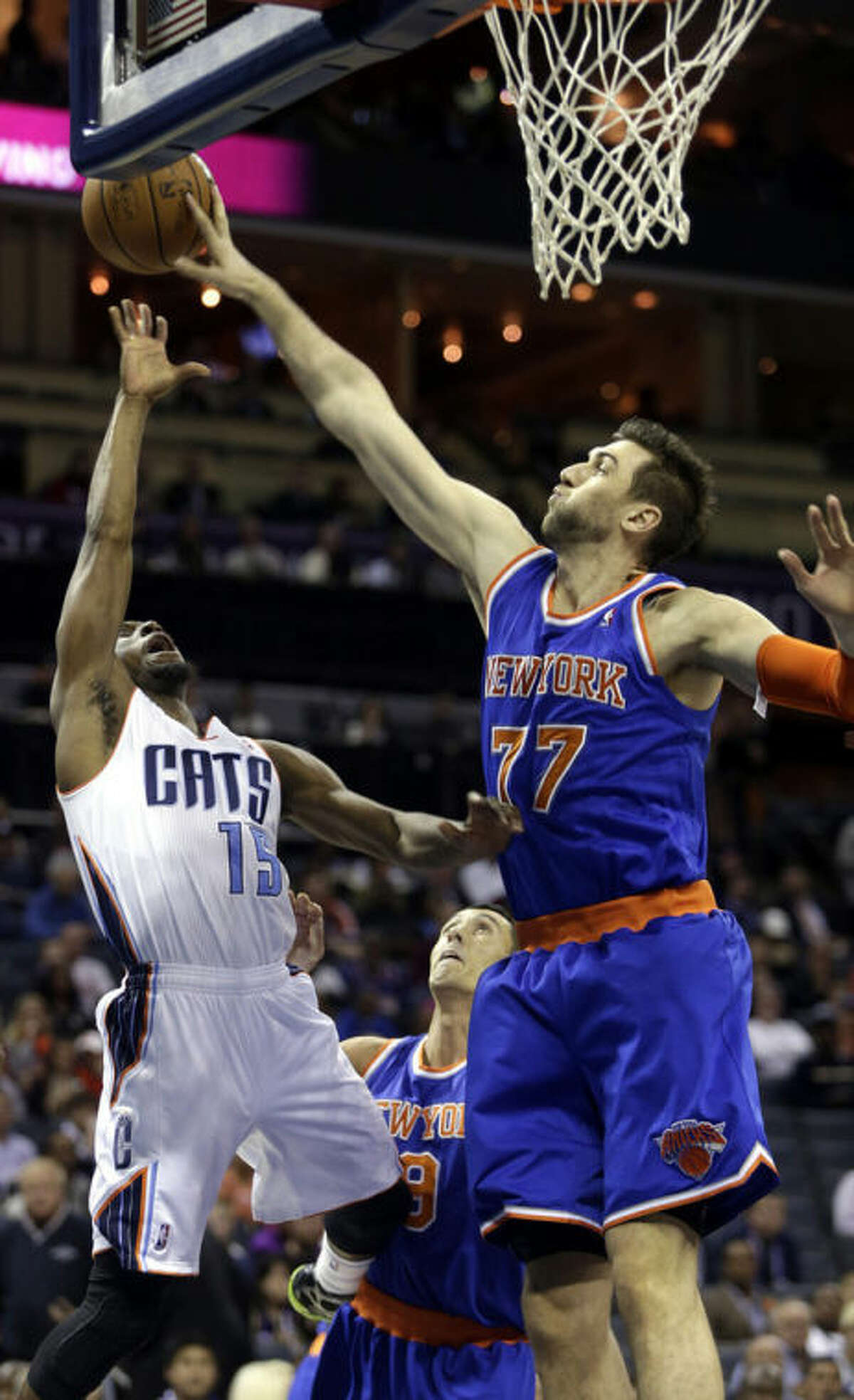 New York Knicks forward Andrea Bargnani, right, of Italy, blocks the shot of Charlotte Bobcats guard Kemba Walker in the first half of an NBA basketball game in Charlotte, N.C., Friday, Nov. 8, 2013. (AP Photo/Nell Redmond)