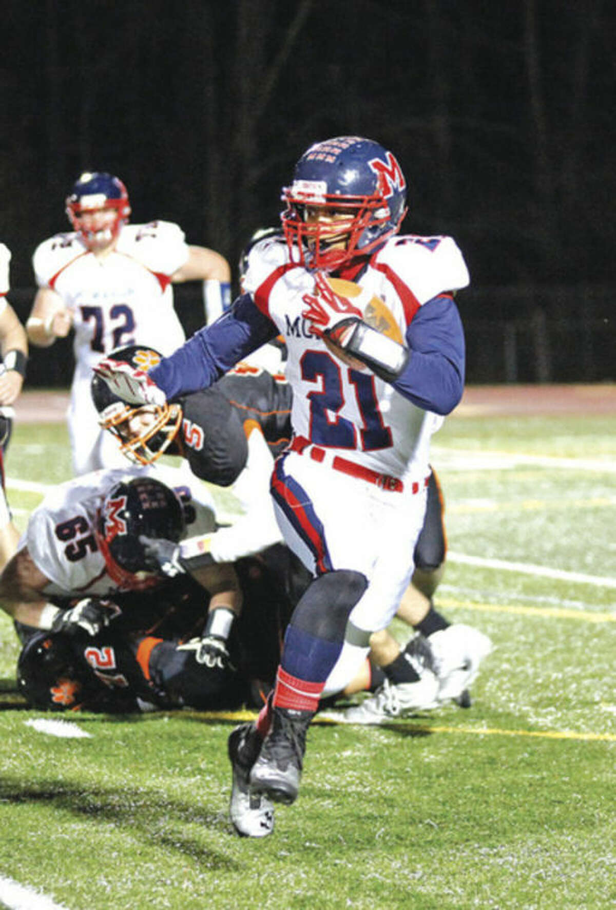 Hour photo/Danielle Calloway Brien McMahon's Timothy Hinton Jr. looks for running room during Friday night's game against Ridgefield. Hinton scored on an 83-yard run, but that was one of the few highlights for the Senators, who suffered their first loss of the season after seven wins. Ridgefield won, 44-7.