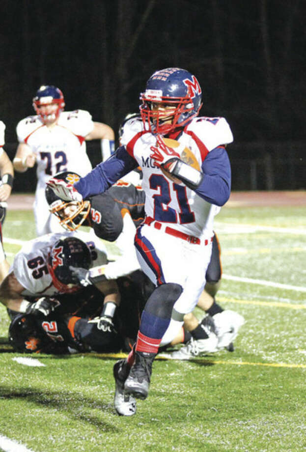 Hour photo/Danielle CallowayBrien McMahon's Timothy Hinton Jr. looks for running room during Friday night's game against Ridgefield. Hinton scored on an 83-yard run, but that was one of the few highlights for the Senators, who suffered their first loss of the season after seven wins. Ridgefield won, 44-7.
