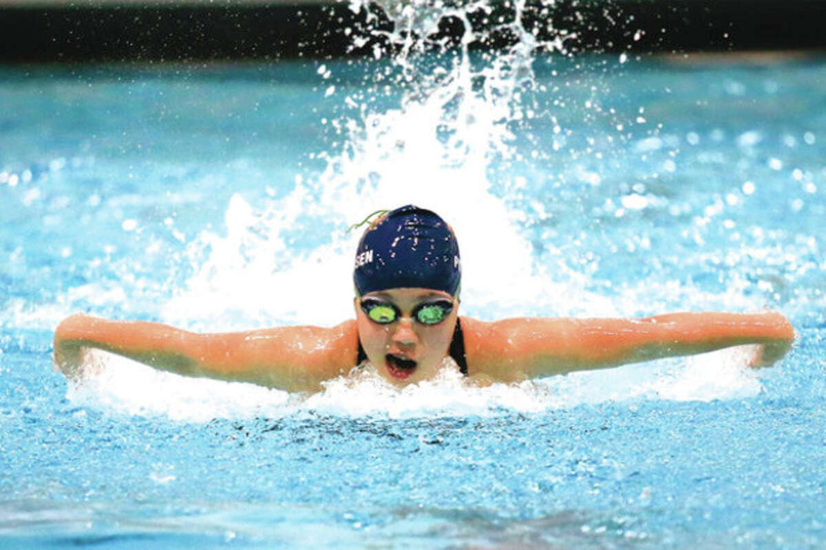Hour photo/Chris Palermo Daisy Peterson competes in the 100 breaststroke during Wednesday's Class S girls swimming championship meet at Wesleyan University in Middletown. Weston won the state title for the third time in four years.