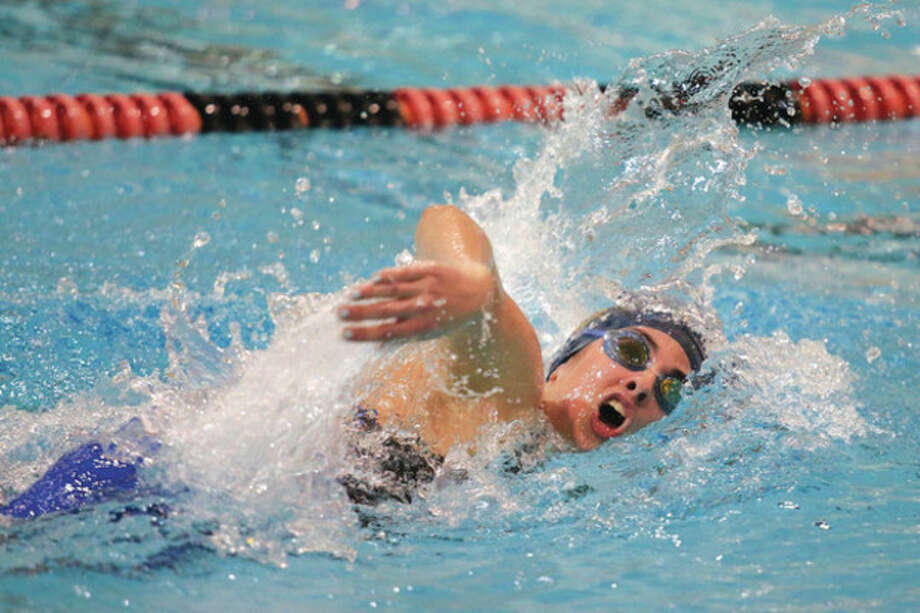 Hour photo/Chris PalermoKiersten Daly swims in the 500 freestyle during the CIAC girls Class S championship at Wesleyan University Wednesday night. Daly had a second and a third in individual events and swam on Weston's victorious 200 medley relay team, as well as the runner-up 400 freestyle realy squad. Weston won its third Class S crown in the last four years. / © 2013 Hour Newspapers All Rights Reserved