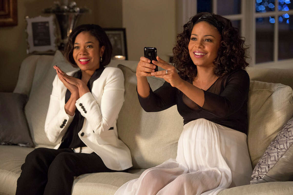 This image released by Universal Pictures shows Regina Hall, left, and Sanaa Lathan in a scene from