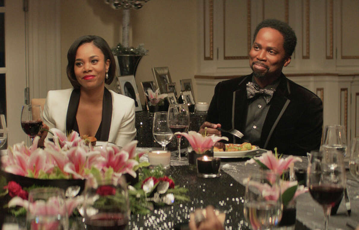 This image released by Universal Pictures shows Regina Hall, left, Harold Perrineau in a scene from
