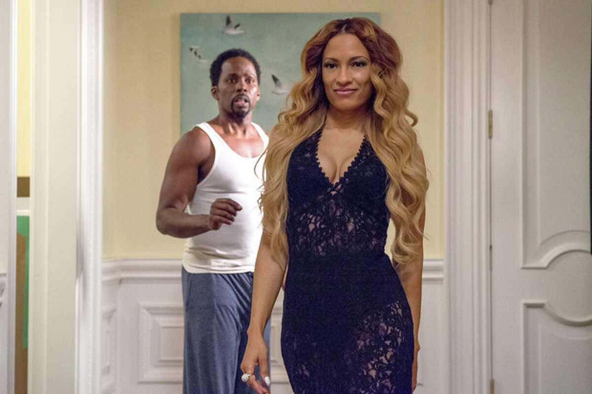This image released by Universal Pictures shows Harold Perrineau, left, and Melissa De Sousa in a scene from