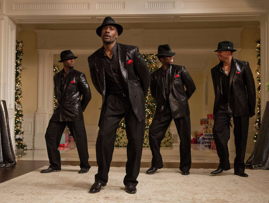 "This image released by Universal Pictures shows, from left, Taye Diggs, Morris Chestnut, Harold Perrineau and Terrence Howard in a scene from ""The Best Man Holiday."" (AP Photo/Universal Pictures, Michael Gibson) / Universal Pictures"
