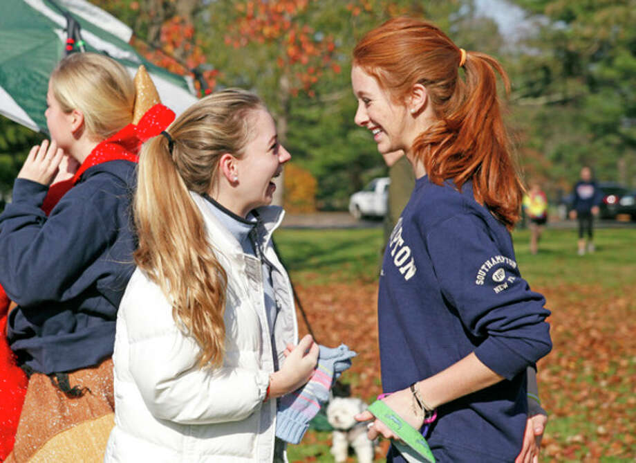 Lizzy Nielsen and Charlotte Galef greet each other at the annual Turkey Trot to benefit The Open Door Norwalk Emergency Shelter at Irwin Park in New Canaan Sunday morning.Hour Photo / Danielle Robinson