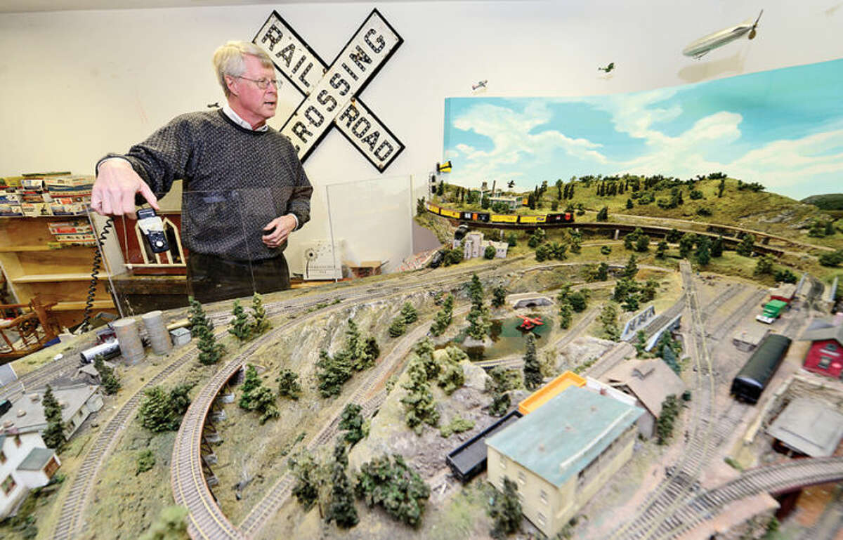 Hour photo / Erik Trautmann Wilton Historical Society volunteer Stephen Desloge prepares for the first annual Holiday Trunk Show and Great Trains Holiday Exhibit. The trunk show wil sell handcrafted merchandise from six local vendors at the society's Betts Store.