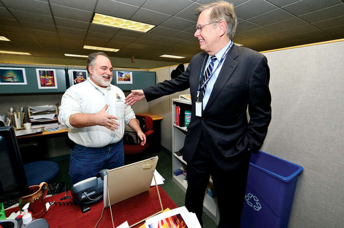 Hour photo / Erik Trautmann Mayor Elect David Martin greets Anthony Piselli in the Citizens Services Center as he tours the Stamford Government Center to meet employees and get familiar with departments personnel.